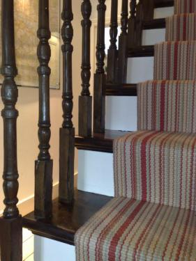 Dark oak varnish finish on stair treads and spindles