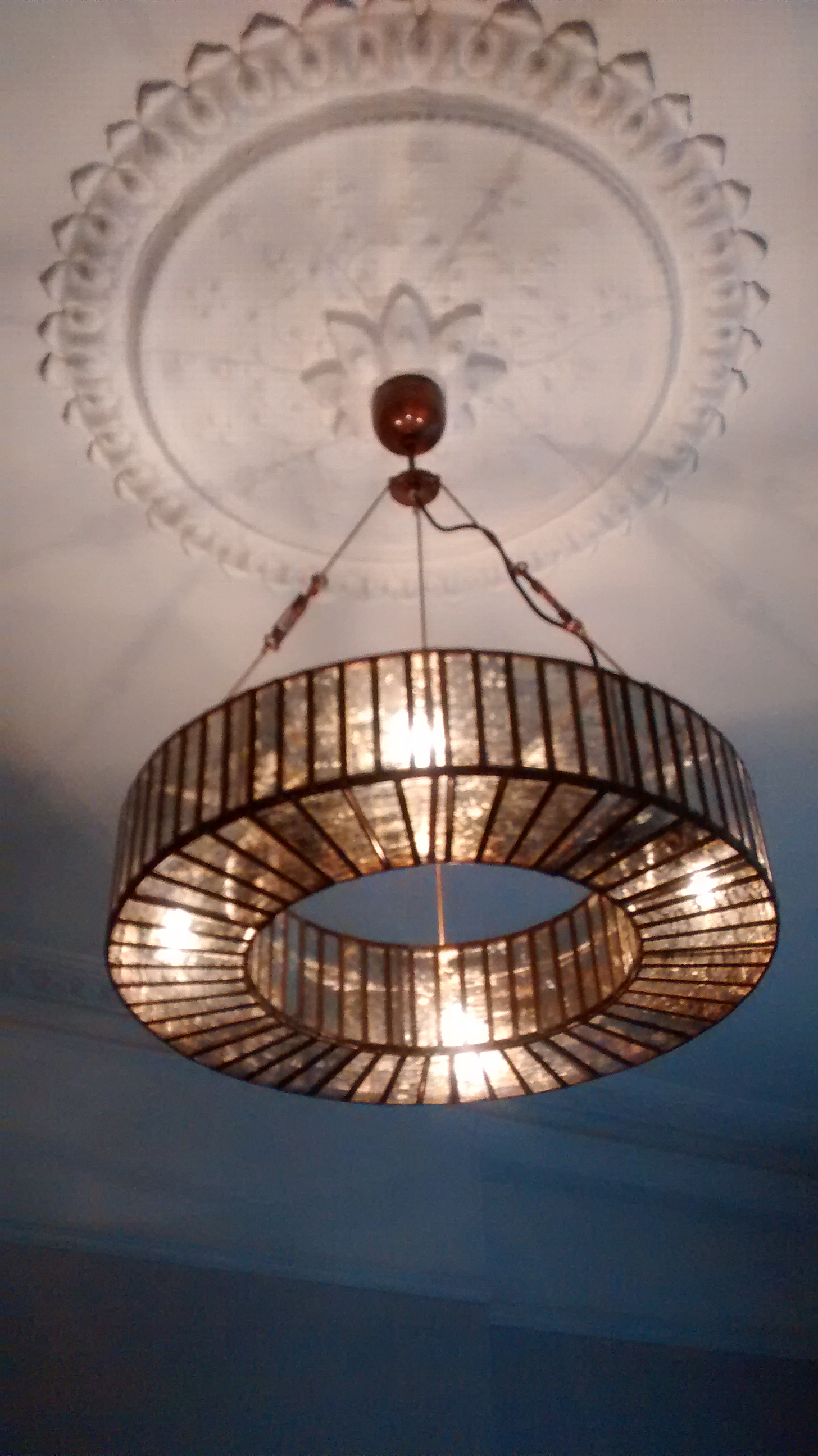 Ceiling-rose-with-metal-and-glass-pendant-light