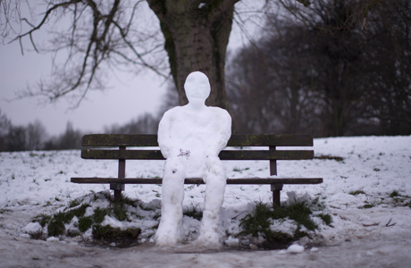 A snowman sits on a bench on Hampstead Heath in London -- AP Photo/Matt Dunham